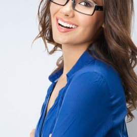 Happy young businesswoman in glasses